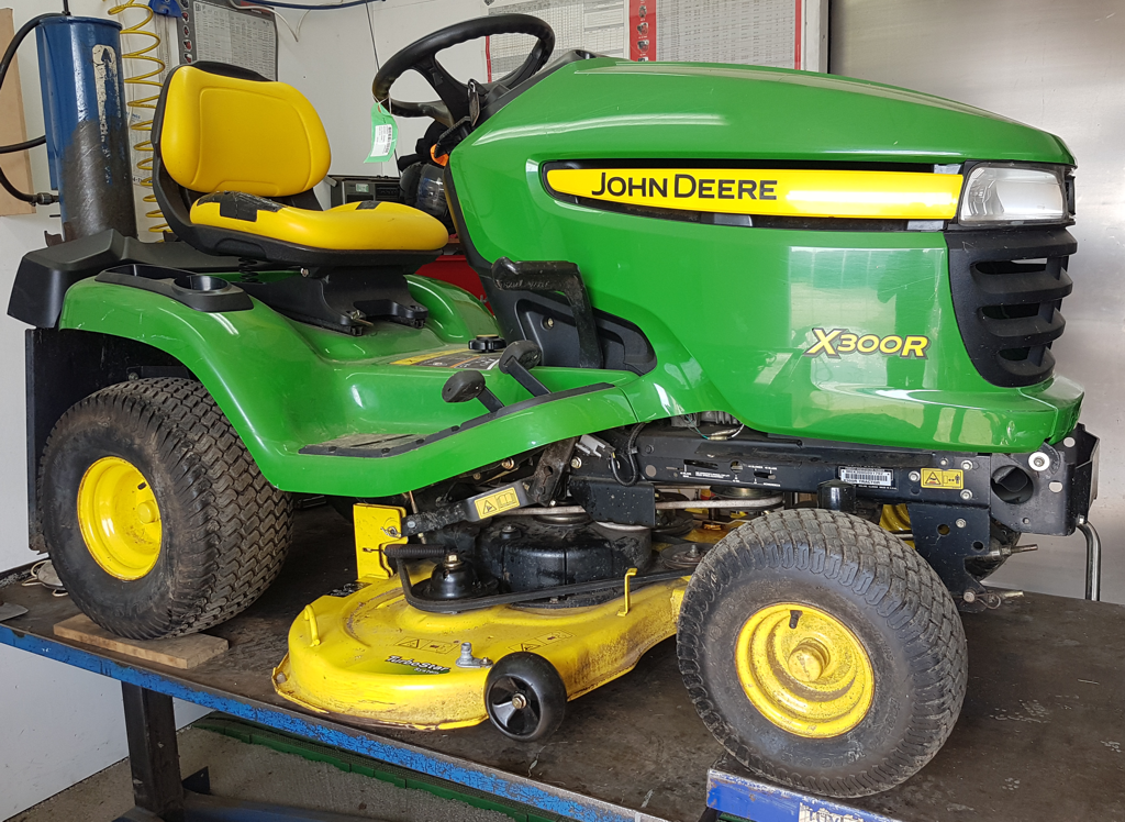 Tractor mower in for service